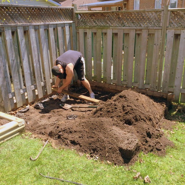 digging up a garden bed - northstory.ca