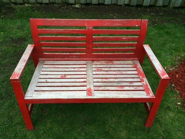 faded red bench - northstory.ca