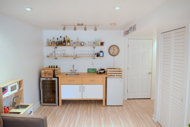 Basement Kitchenette - Bar featuring pipe shelves and an IKEA VARDE cabinet - northstory.ca