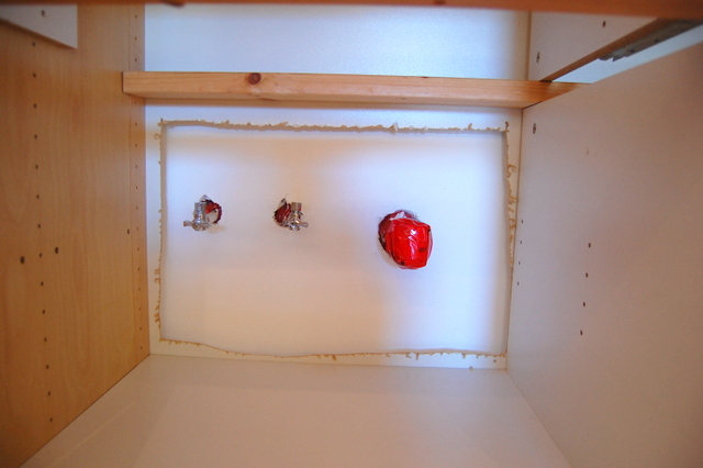 Making room for plumbing in the VARDE cabinet - northstory.ca