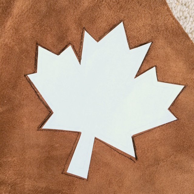 maple leaf stencil on back of leather - northstory.ca
