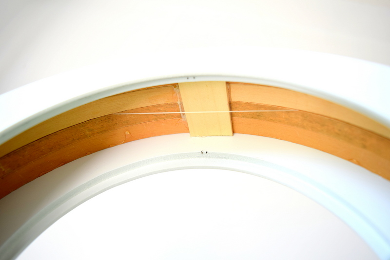 Use a piece of wood to hold the embroidery hoops together - northstory.ca