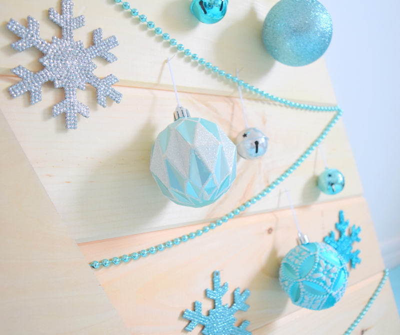 Close up of Martha Stewart ornaments available at Home Depot on wood Christmas tree - northstory