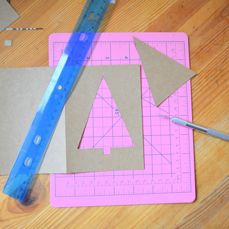 Cutting out a tree shape in kraft cardstock
