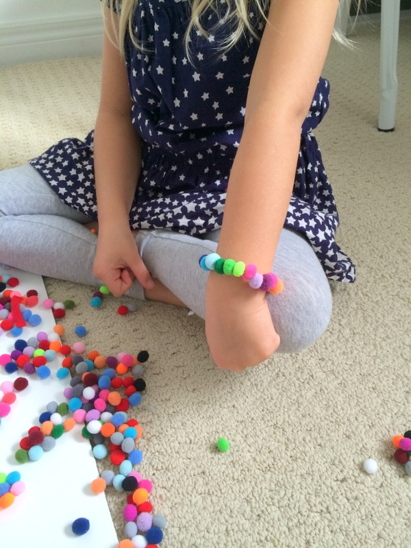 Making pom pom ornaments and bracelets - northstory