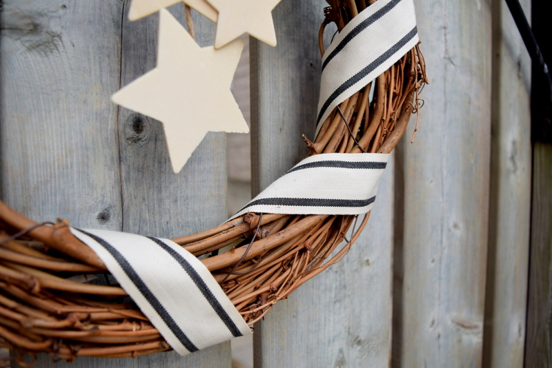 May Arts Stripes Ribbon on a wreath with wood stars - northstory