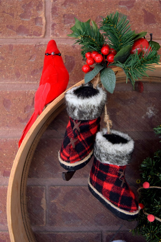 close-up-of-the-cardinal-and-skates-on-the-christmas-wreath